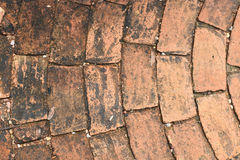 Old brick as floor tile Stock Photo