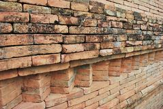 Old Brick Background. Background of Old Damaged Red Variegated Brick with Concrete Smoothing Stock Photography