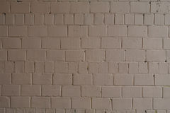 Old brick brick wall painted with brown paint for texture and background Royalty Free Stock Photography