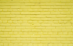 Old brick brick wall painted with yellow paint for textures or backgrounds Royalty Free Stock Photography