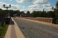 old Brick bridge across the River Venta in the city of Kuldiga Royalty Free Stock Image