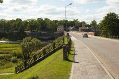 Old Brick bridge across the River Venta in the city of Kuldiga Stock Photo
