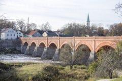 Old Brick bridge across the River Venta in the city of Kuldiga Latvia Royalty Free Stock Images