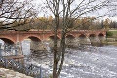 Old Brick bridge across the River Venta in the city of Kuldiga Latvia Royalty Free Stock Image