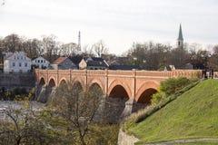 Old Brick bridge across the River Venta in the city of Kuldiga Latvia Royalty Free Stock Photos