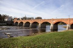 Old Brick bridge across the River Venta in the city of Kuldiga Latvia Stock Photography