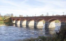 Old Brick bridge across the River Venta in the city of Kuldiga Latvia Stock Photo