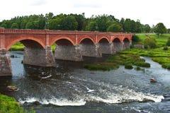 Venta waterfall, the widest waterfall in Europe, Kuldiga, Latvia. Old brick bridge across the river Venta in the city of Kuldiga, Latvia Stock Image