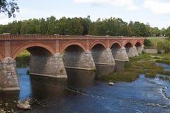 Old Brick bridge across the River Venta in the city of Kuldiga. Latvia Royalty Free Stock Photography