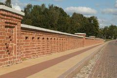 Old Brick bridge across the River Venta in the city of Kuldiga Royalty Free Stock Images
