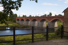 Old Brick bridge across the River Venta in the city of Kuldiga Royalty Free Stock Photography