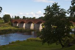 Old Brick bridge across the River Venta in the city of Kuldiga. Latvia Royalty Free Stock Image
