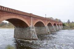 Old Brick bridge across the River Venta in the city of Kuldiga Latvia Royalty Free Stock Photography