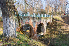 The old brick bridge. Old brick bridge with arches. Bright Sunny autumn day in the town of Tutaev, Yaroslavl region Stock Photography