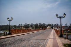 The old brick bridge, Latvia. Famous old red brick bridge of Kuldiga, Latvia. Street view with lanterns Royalty Free Stock Image