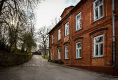 Old Brick Building. In city center. Shot taken in Kandava, Latvia. No people in the background Stock Photos