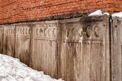 Old brick building with concrete fence Royalty Free Stock Photo