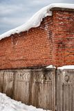 Old brick building with concrete fence Stock Image