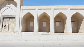 Ancient architecture of Central Asia and East. An old brick building, with elements of arches. Ancient buildings of medieval Asia. Bukhara, Uzbekistan stock footage