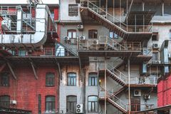 Old brick building facade in an industrial zone royalty free stock photo
