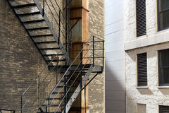 Old brick building with fire escape stairs Stock Image
