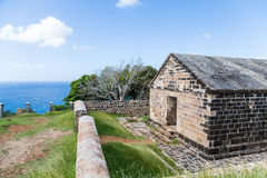 Old Brick Building on Hill in Antigua. An old abandoned stone building on the hilltops of Antigua in the Caribbean royalty free stock images