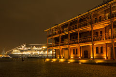 Old brick building. Light up old brick building in front of cruise ship in Yokohama at night Royalty Free Stock Images