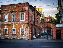 An old brick building and a metal fence Royalty Free Stock Photo