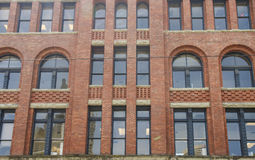 Old Brick Building with Paladium Windows Stock Photography