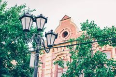 Old brick building and street lamp stock images
