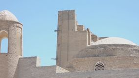 Ancient architecture of Central Asia and East. An old brick building with a tower. Ancient buildings of medieval Asia. Bukhara, Uzbekistan stock video