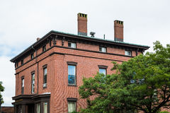 Old Brick Building with Two Chimneys Stock Photo