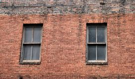 Old brick building with windows Royalty Free Stock Images