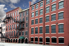 Old Brick Buildings. A photo of a typical row of brick buildings found in the United States of America. Features specialty shops, apartments and restaurants Stock Images
