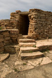 Old brick cave entrance and stone stairs. Weathered bricks, ancient monument, Kazakhstan Stock Photography