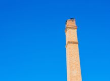 Old brick chimney on the background of clear  blue sky Stock Images