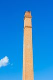 Old brick chimney on the background of clear  blue sky Royalty Free Stock Photography
