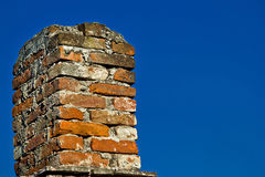 Old brick chimney and blue sky Royalty Free Stock Images