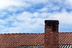 Old brick chimney. Chimney with sky in the background. Eco-friendly heating of a family house. Old brick chimney. Chimney with sky in the background. Eco Royalty Free Stock Photos