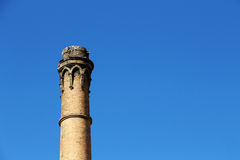 Old brick chimney, industrial archeology. A detailed view of an old brick chimney, against a bright blue sky, chemical industry, from palermo, sicily, space for Stock Photos