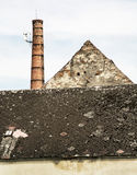 Old brick chimney and roof, retro architectural scene, vertical. Old brick chimney and roof. Retro architectural scene. Abandoned building. Vertical composition Stock Images