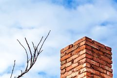 Old brick chimney. Chimney with sky in the background. Eco-friendly heating of a family house. Old brick chimney. Chimney with sky in the background. Eco Royalty Free Stock Photo