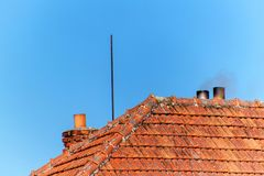 Old brick chimney. Chimney with sky in the background. Eco-friendly heating of a family house. Old brick chimney. Chimney with sky in the background. Eco Royalty Free Stock Photography