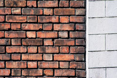 Old brick and concrete wall. Image of old brick wall joint with white painted and engraved concrete wall Royalty Free Stock Photography