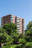 Old Brick Condos with White Balconies Royalty Free Stock Photography