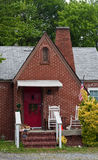 Old Brick Cottage with Red Door Stock Images