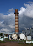 Old brick factory and chimney. Urban background. Old brick factory and chimney. Industrial background royalty free stock photography