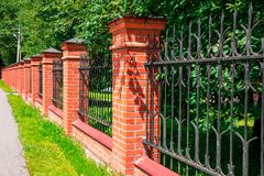 Brick fence in perspective Stock Images