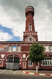 Old brick fire tower with tree in Yelets, Russia Royalty Free Stock Photos
