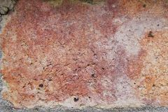 Old Brick of a Fireplace. Background of an old fireplace brick with rust, yellow, and pink to plum colors. Horizontal Stock Images
